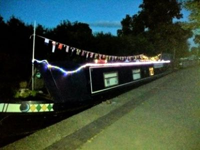One of our brightly lit boats on the Ellesmere Canal arm.