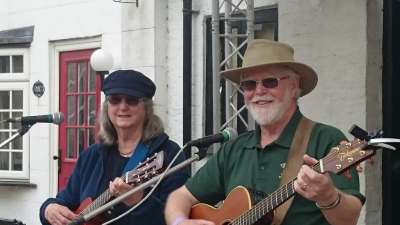 James & Hazel Bell with guitars. Playing a set at Rickmansworth Festival.