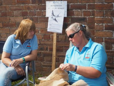 Tracey Clarke demonstrating her Rag Rugging at the Ellesmere Festival.